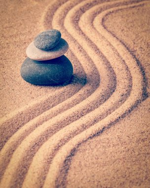 Vintage retro effect filtered hipster style image of Japanese Zen stone garden - relaxation, meditation, simplicity and balance concept  - pebbles and raked sand tranquil calm scene stock vector