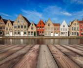 Photo Wooden planks table with European town in background