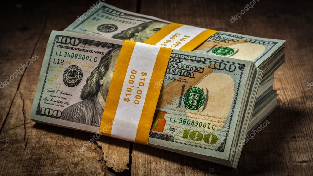 Stacks of new 100 US dollars banknotes — Stock