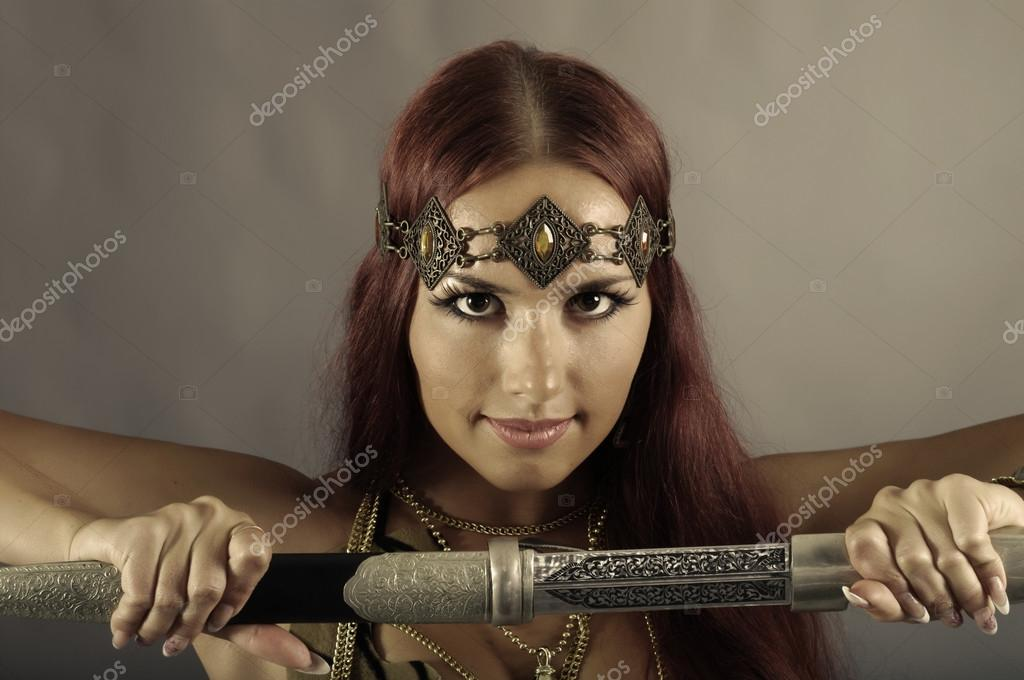 woman holding sword - 1024×680