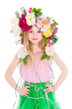 Little girl posing with flowers wreath