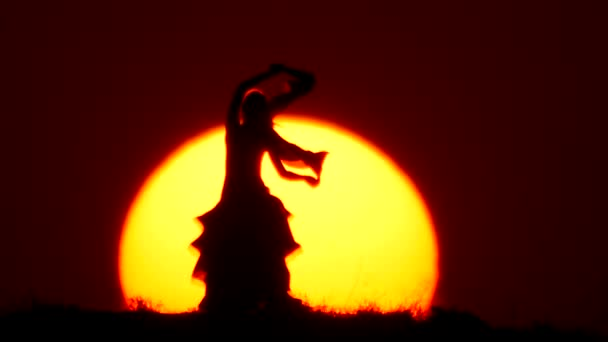 Silhouette of a dancer dancing at sunset