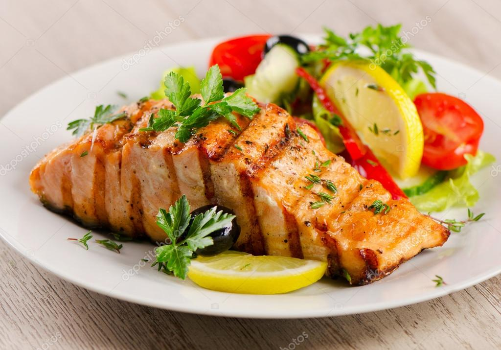 Grilled Salmon with  salad .