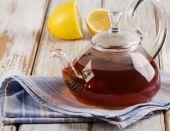 Fotografie Teapot of tea with lemon