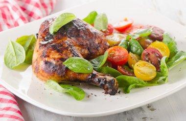 Chicken leg with fresh salad