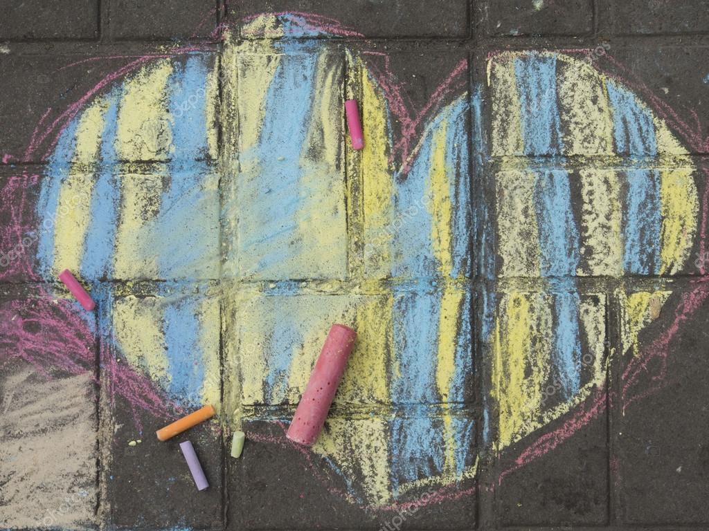 Children's drawings on the sidewalk.