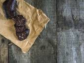 Blood sausage on crumpled wrapping paper