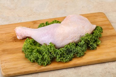 Raw uncooked chicken leg for cooking