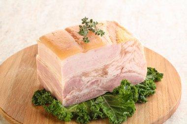 Cut of homemade pork bacon over board