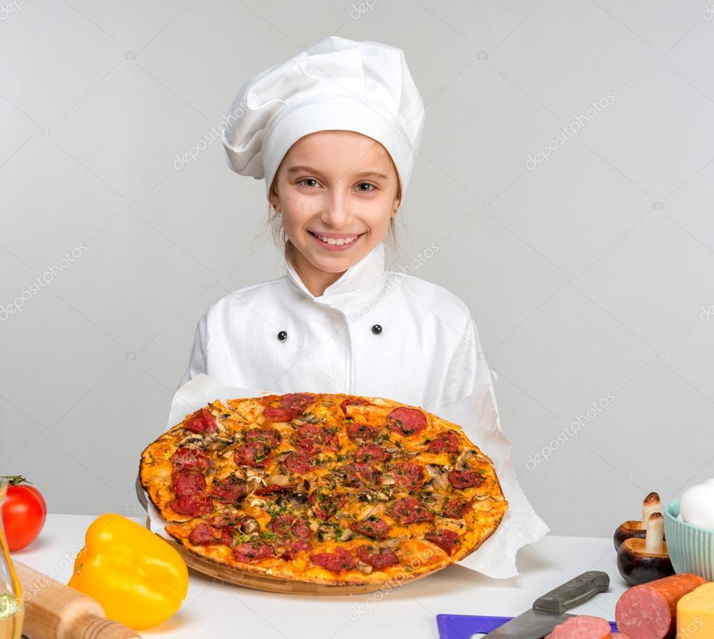 little girl-cook with pizza in hands