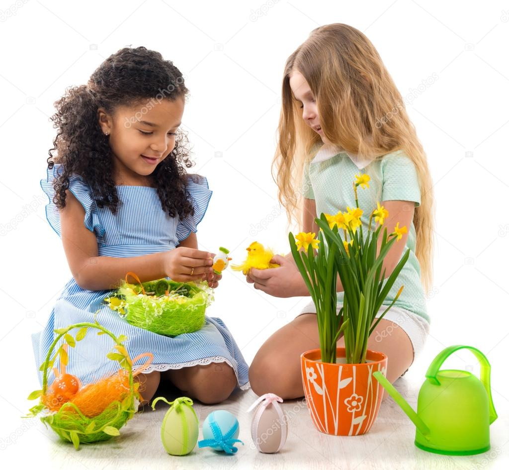 little girls playing chicken toys