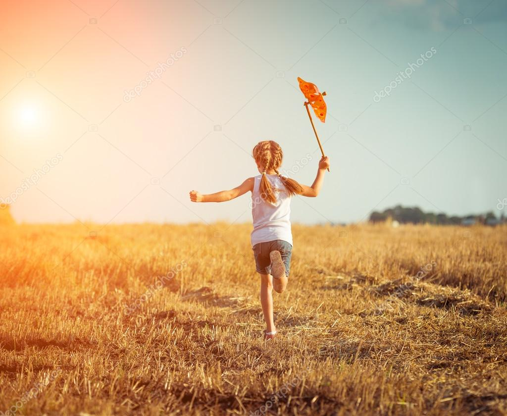 Little girl with a  windmill