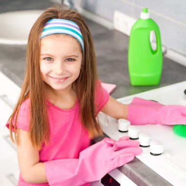 Girl make cleaning in  kitchen
