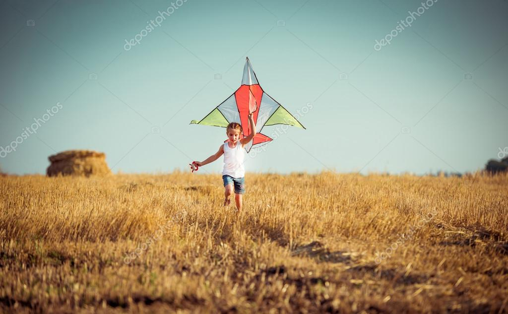 Happy little girl with  kite