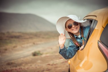 little girl traveling by car