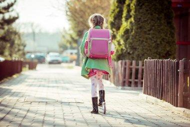 girl goes to school