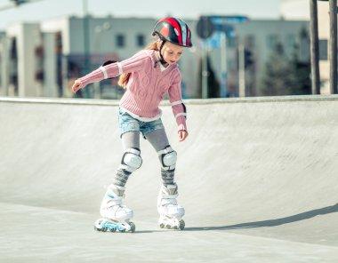Little pretty girl on roller skates