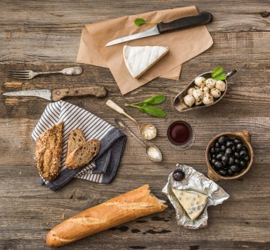 Cheese and other ingredients on table