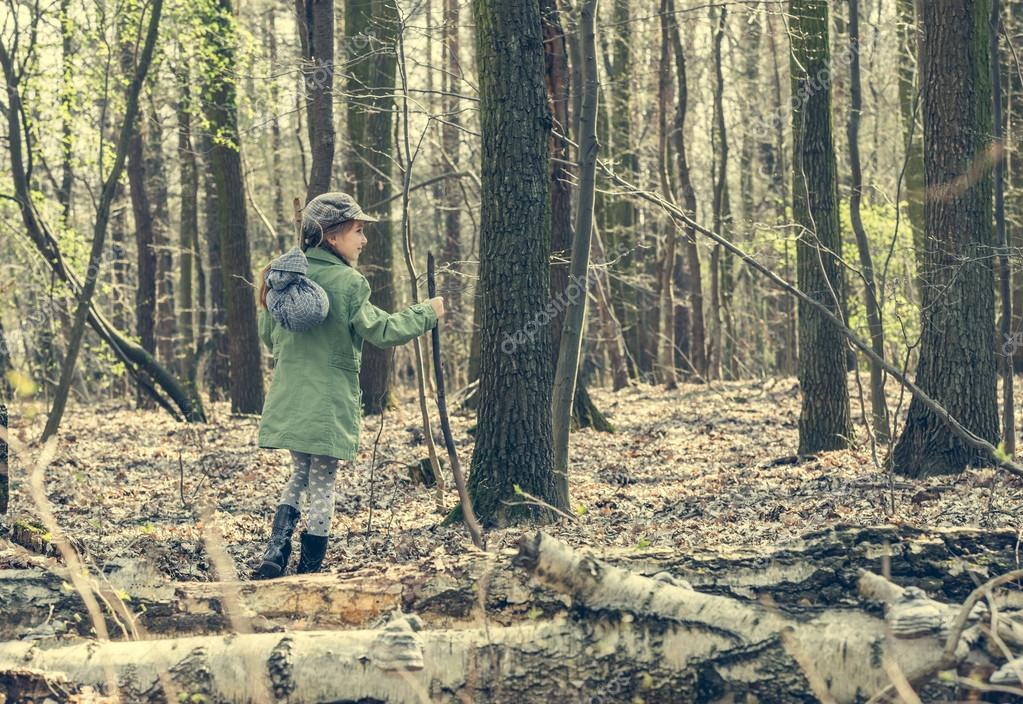 little girl goes through the woods