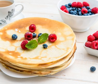 breakfast with pancakes on  table