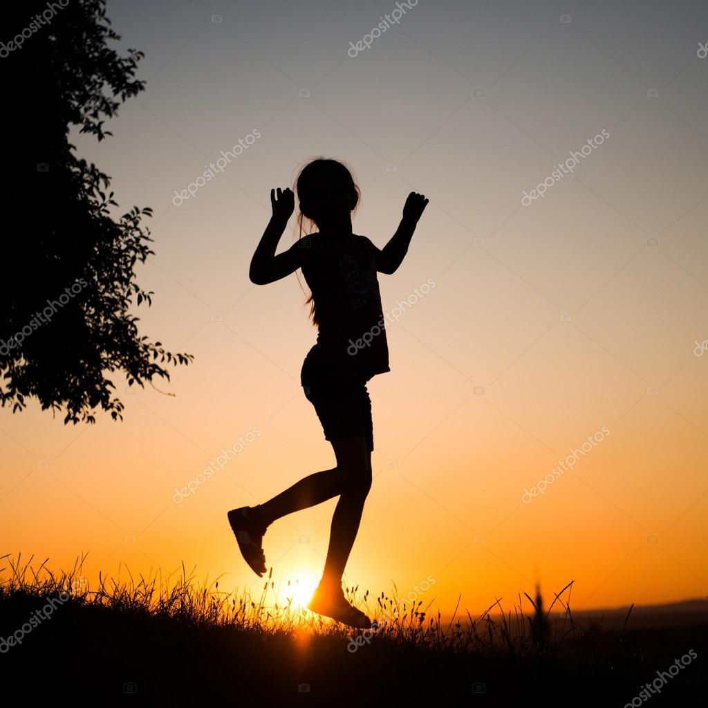 teenager girl  in the setting sun