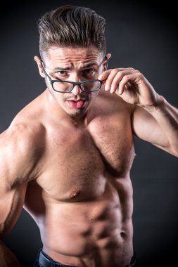 Muscular young man in glasses