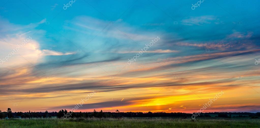 Beautiful sunrise over green field