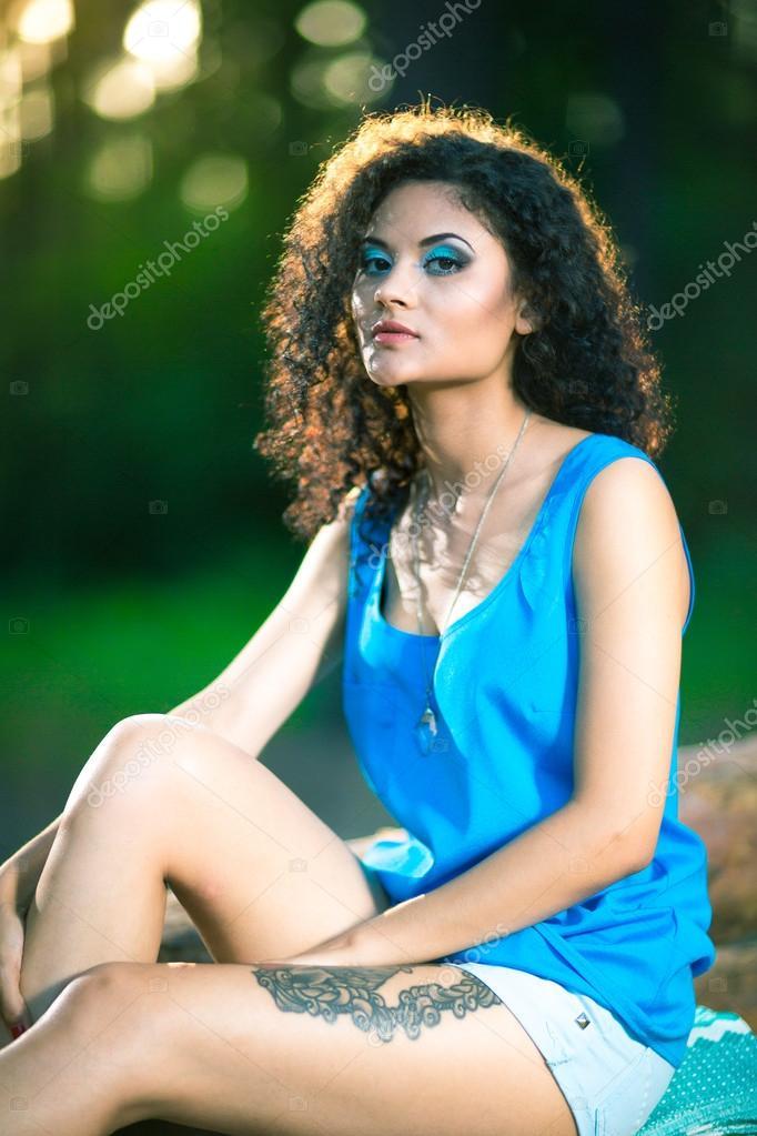Woman sitting on log