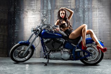 Sexy woman on motorcycle.