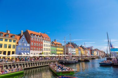 Nyhavn district is one of the most famous place  in summer day in Copenhagen, Denmark stock vector