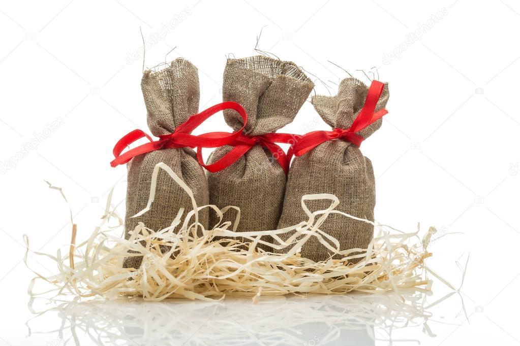 Drei kleine Geschenk Säcke — Stockfoto © gerasimov #60730089