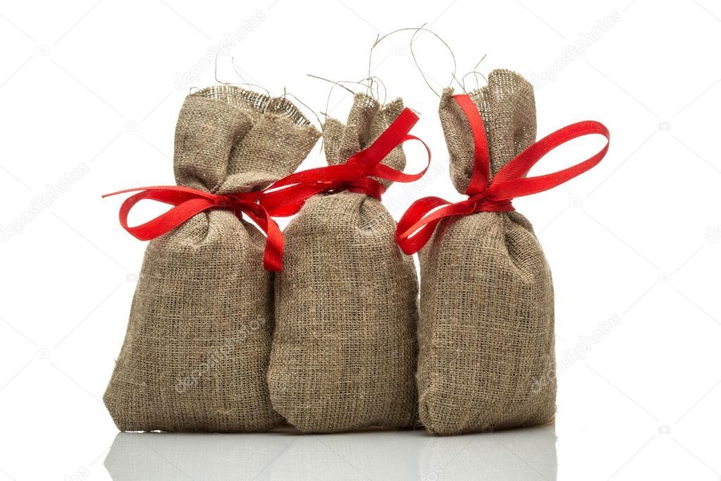 Drei kleine Geschenk Säcke — Stockfoto © gerasimov #60730091