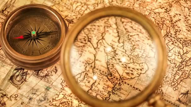 Vintage compass on ancient map