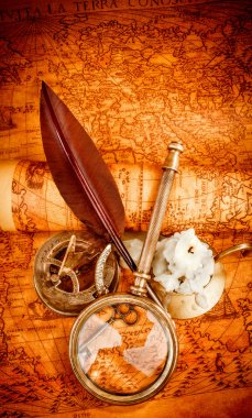 Vintage still life. Vintage items on ancient map.