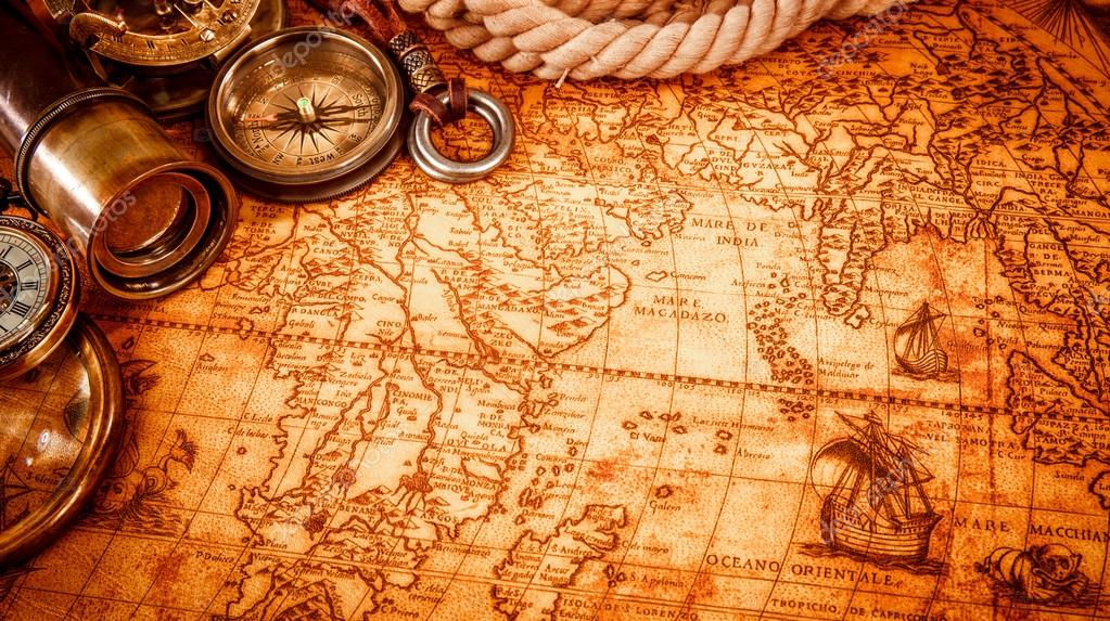 Vintage magnifying glass lies on an ancient world map stock photo vintage magnifying glass lies on an ancient world map stock photo gumiabroncs Images