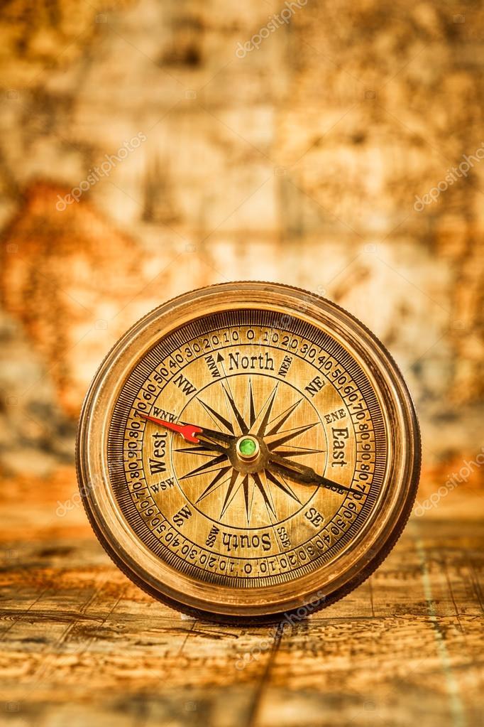 Vintage compass lies on an ancient world map stock photo vintage compass lies on an ancient world map stock photo gumiabroncs Image collections