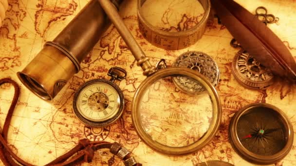 Vintage magnifying glass, compass, telescope and a pocket watch lying on ancient world map in 1565.