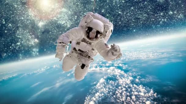 Űrhajós a világűrben, a földön a háttérben. Ez a kép a Nasa berendezett elemei