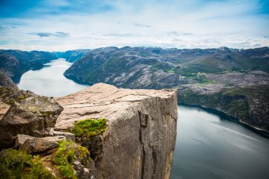 Preikestolen or Prekestolen, also known by the English translations of Preacher's Pulpit or Pulpit Rock, is a famous tourist attraction in Forsand, Ryfylke, Norway stock vector