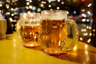Two cups of beer in a pub