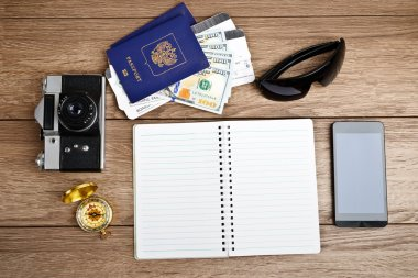 tourism concept: air tickets, passports, smartphone, compass, ca