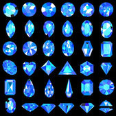 Fotografie set of blue gems of different cuts and shapes