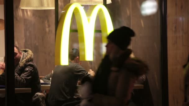 People sitting at McDonalds restaurant