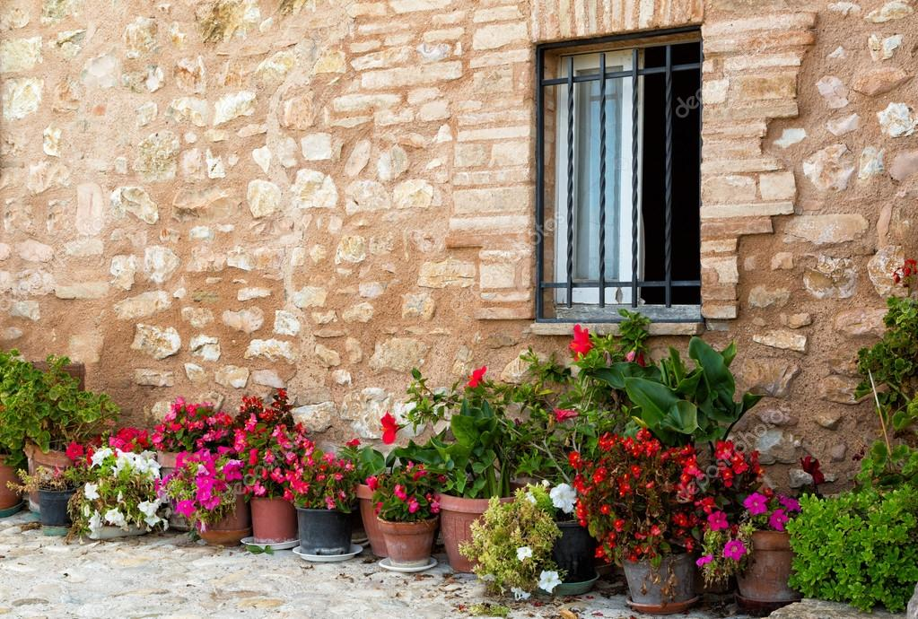 Plants in pots on narrow streets of the ancient city of Spello