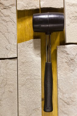 Black rubber mallet and facing stones