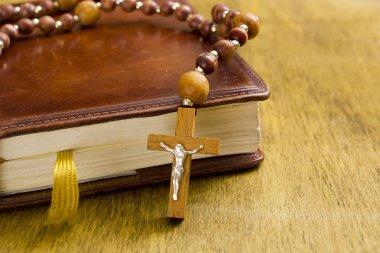 Catholic cross on the book