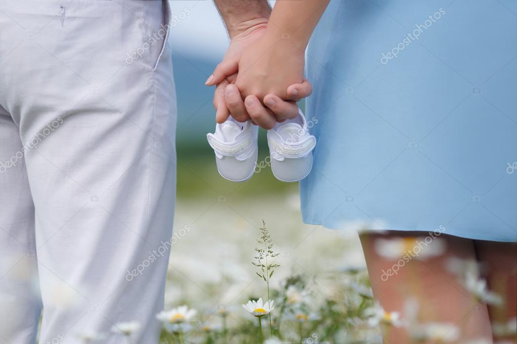 Happy couple on a meadow among the flowers