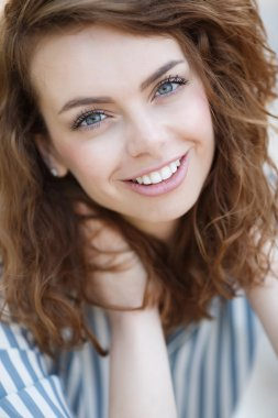Summer portrait of a beautiful girl
