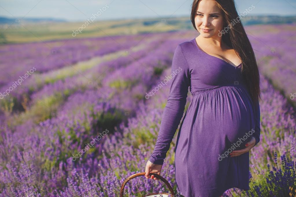 A pregnant woman is enjoying the color Lavender