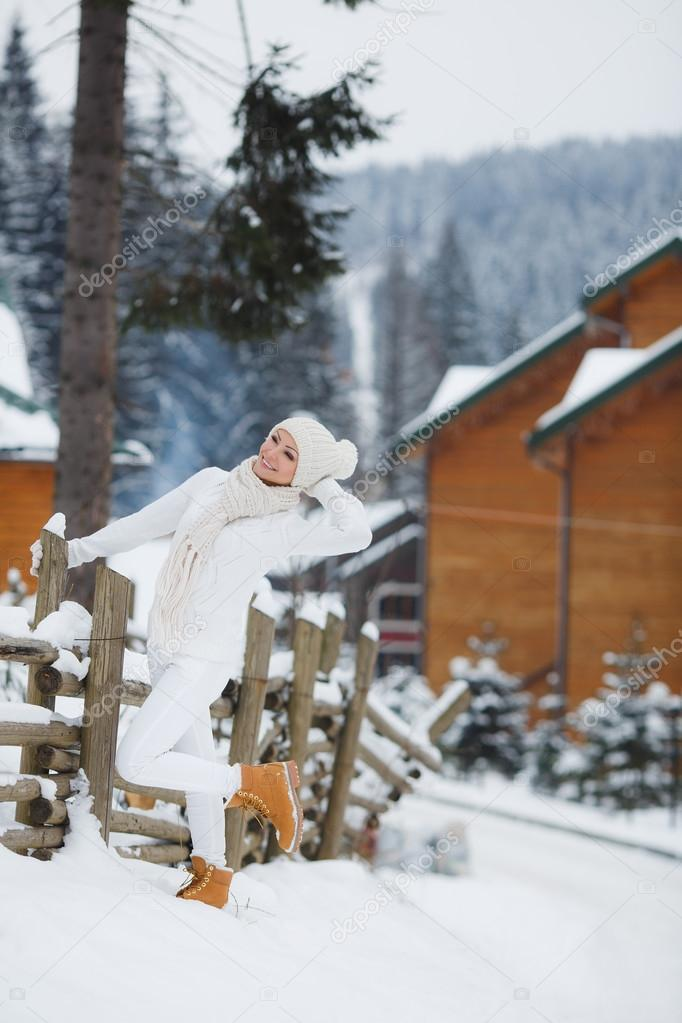 Beautiful girl on a background of a winter landscape.